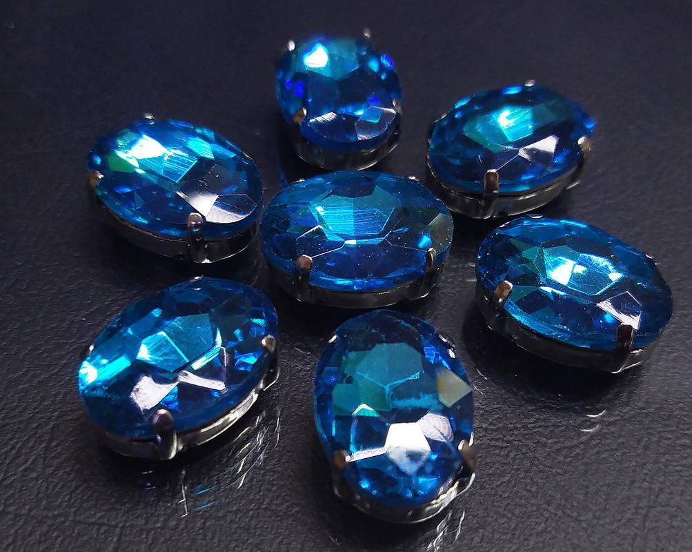 ОЦ010НН1318 Хрустальные стразы в цапах овальной формы, голубой 13х18 мм, 3 шт. оптом