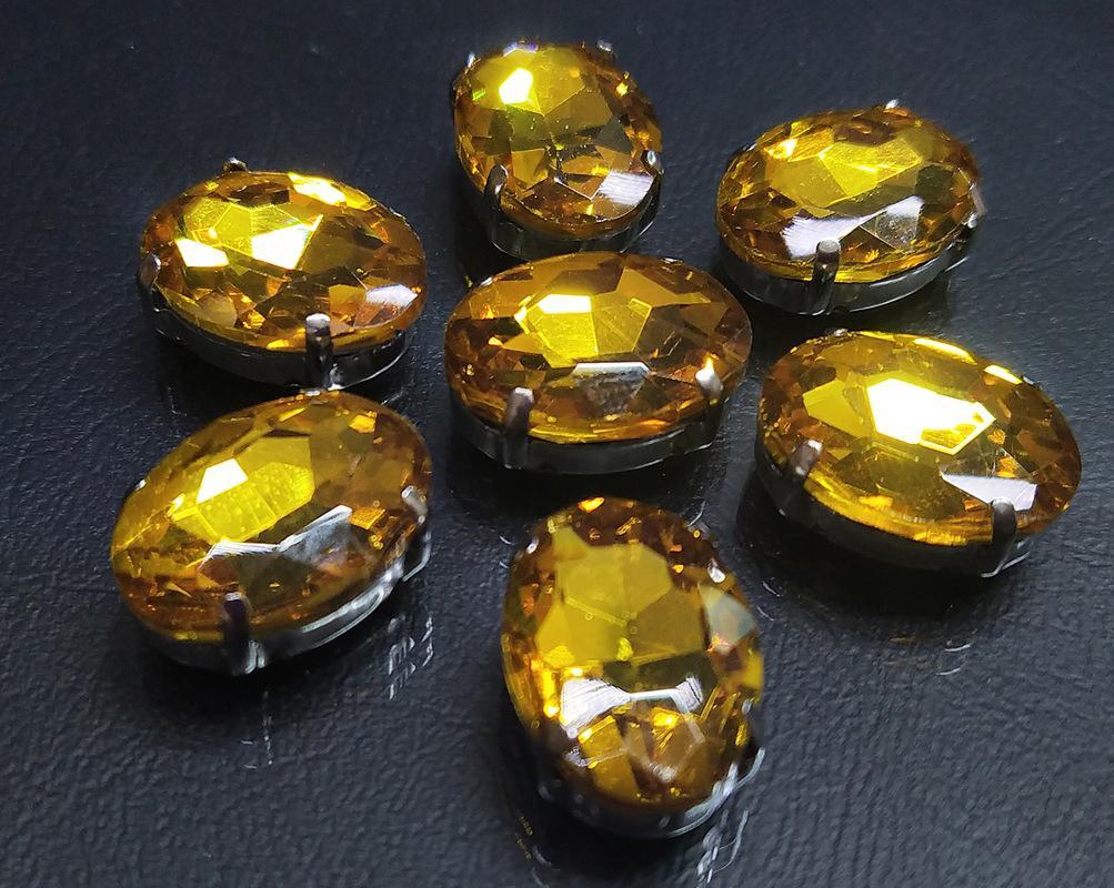 ОЦ004НН1318 Хрустальные стразы в цапах овальной формы, желтый 13х18 мм, 3 шт. оптом