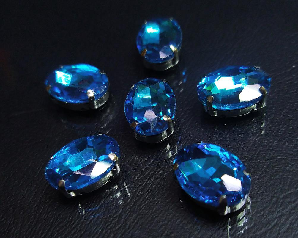 ОЦ010НН1014 Хрустальные стразы в цапах овальной формы, голубой 10х14 мм, 5 шт. оптом
